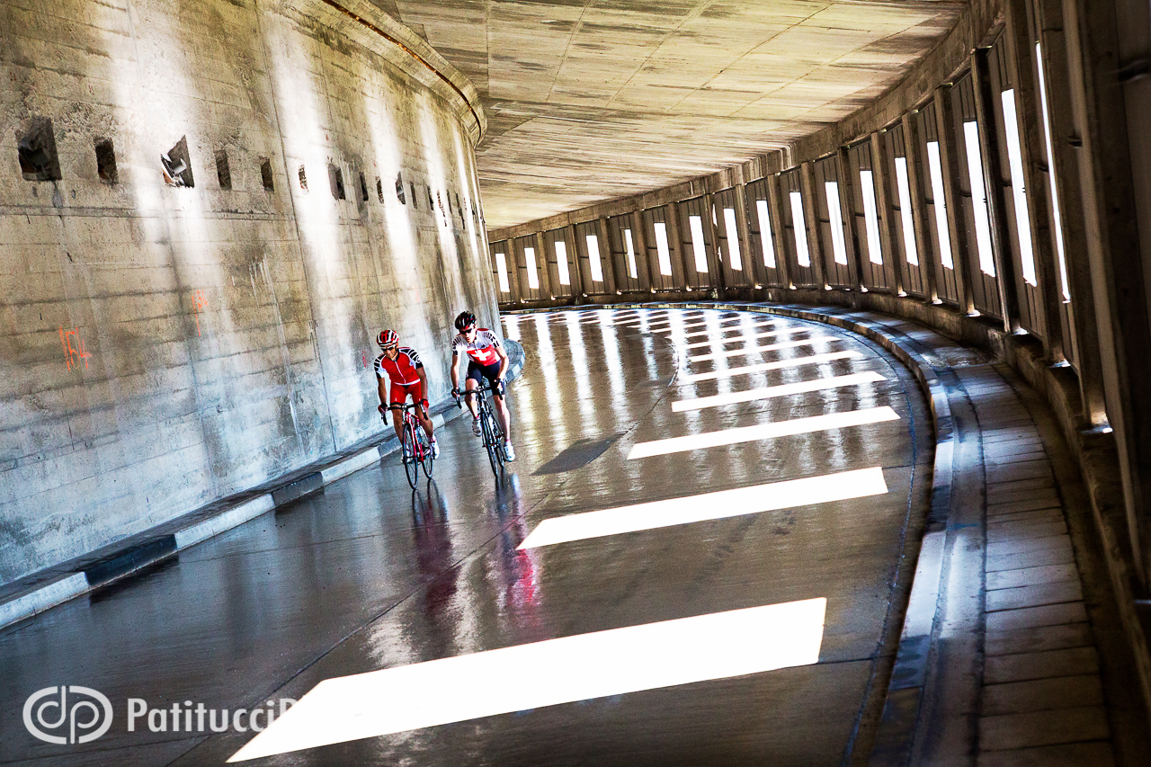Road bikers in tunnel