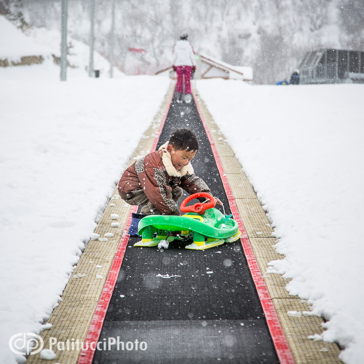 Korean child with sled