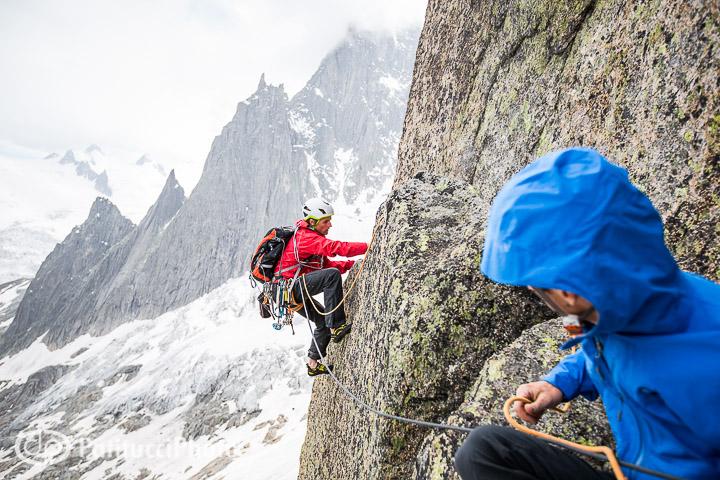Climber belaying partner