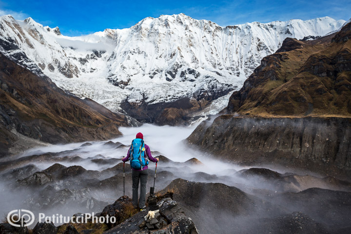 A hiker stands in the moody landscape at Annapurna, Nepal