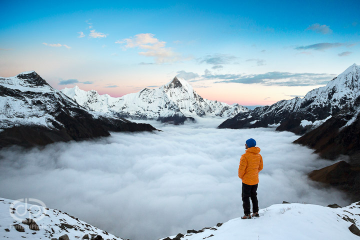 Hiker looking out at sea of clouds