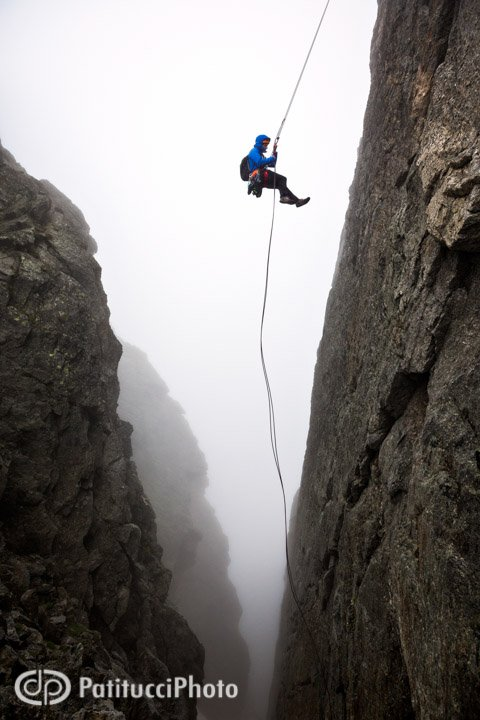 Brendan Leonard rapping into a very unfriendly gulley during a descent in the Sciora group, Switzerland. And yes, it's raining...