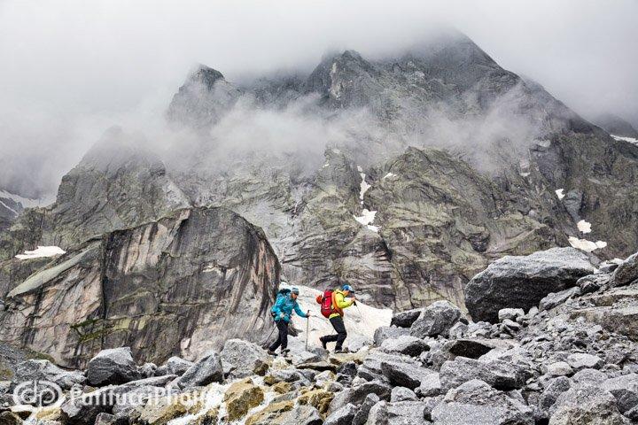 Janine and Simon on the move in the Sciora group, Val Bregaglia, Switzerland.