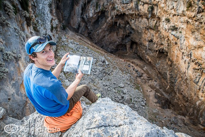 Climber with guidebook at Sikati Cave
