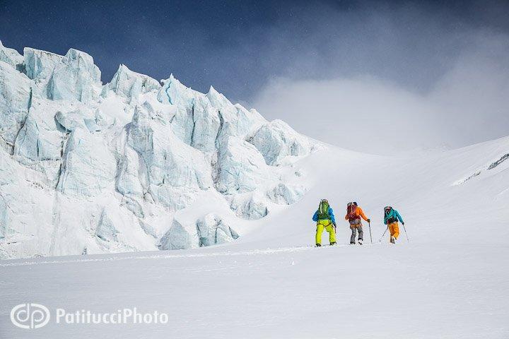 Backcountry skiing beneath seracs on a glacier