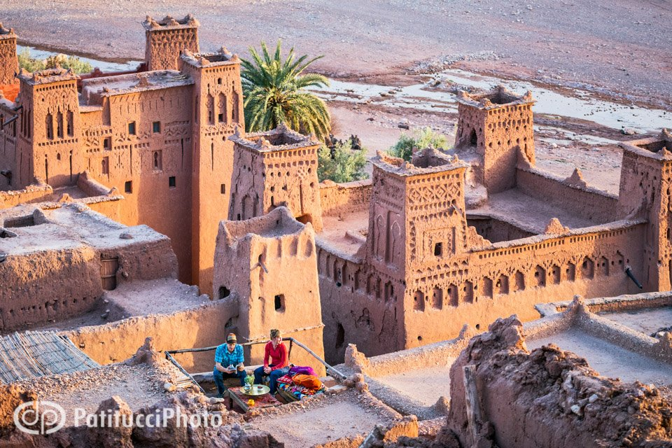 Travelers exploring the ancient city of Ait Ben Haddou where visitors can shop, drink tea and walk through the old city. Morocco