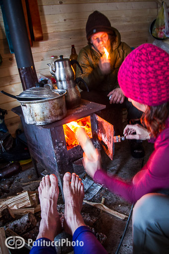 Stoking a woodstove