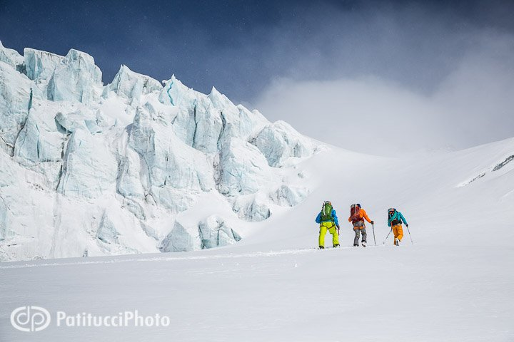 Backcountry skiing beneath seracs on a glacier