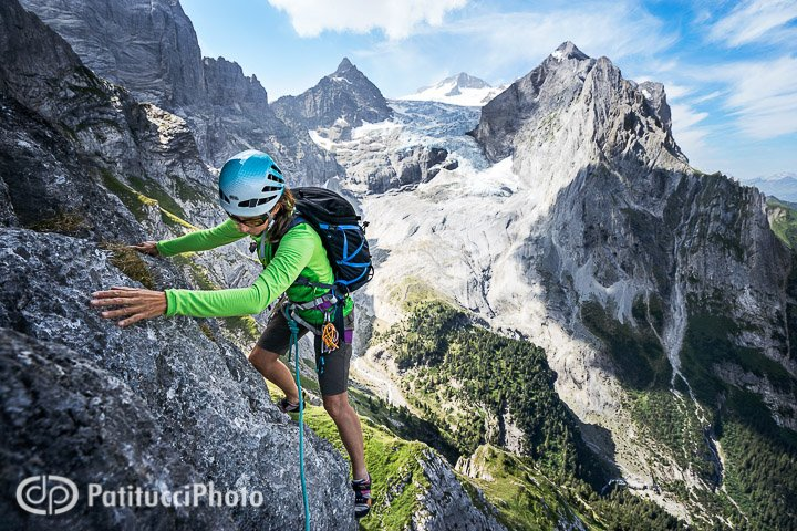 Climbing the Engelhörner's Rosenlauistock with the Wellhorn and Wetterhorn behind, Switzerland
